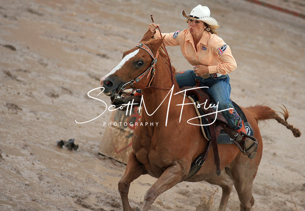 San Antonio's Professional Women's Barrel Racer Liz Pinkston clears the field in an impressive 18.13 seconds despite the muddy field conditions, 28 July 2007, Cheyenne Frontier Days
