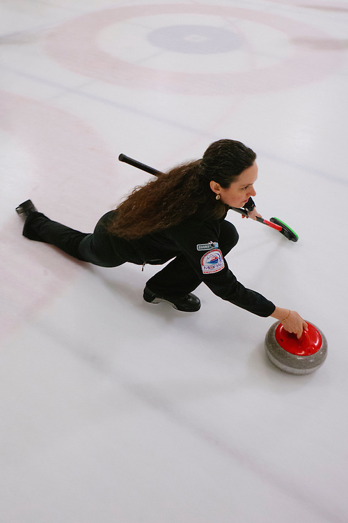 Gabrielle Coleman of Mountain delivers during the San Francisco Bay Area Curling Club's Tuesday night league at Sharks Ice in San Jose on Jan.15, 2013.
