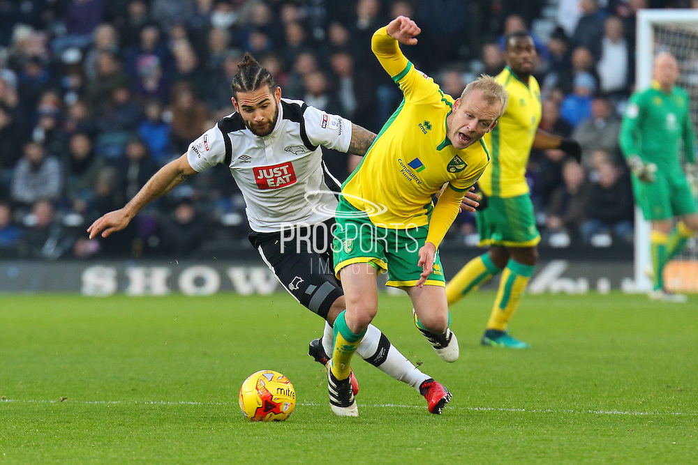 Derby County midfielder Bradley Johnson (15) and Norwich City forward Steven Naismith (7) challenge for the ball during the EFL Sky Bet Championship match between Derby County and Norwich City at the iPro Stadium, Derby, England on 26 November 2016. Photo by Aaron  Lupton.