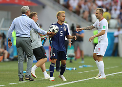 VOLGOGRAD, June 28, 2018  Poland's head coach Adam Nawalka (1st L) gives the ball to Yuto Nagatomo of Japan (2nd R) during the 2018 FIFA World Cup Group H match between Japan and Poland in Volgograd, Russia, June 28, 2018. Poland won 1-0. Japan advanced to the round of 16. (Credit Image: © Yang Lei/Xinhua via ZUMA Wire)