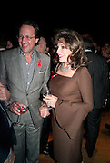 PERCY GIBSON; JOAN COLLINS, The Lighthouse Gala auction in aid of the Terrence Higgins Trust. Christies. London. 19 March 2012.