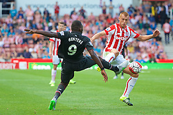 STOKE-ON-TRENT, ENGLAND - Sunday, August 9, 2015: Liverpool's Christian Benteke in action against Stoke City's Steve Sidwell during the Premier League match at the Britannia Stadium. (Pic by David Rawcliffe/Propaganda)