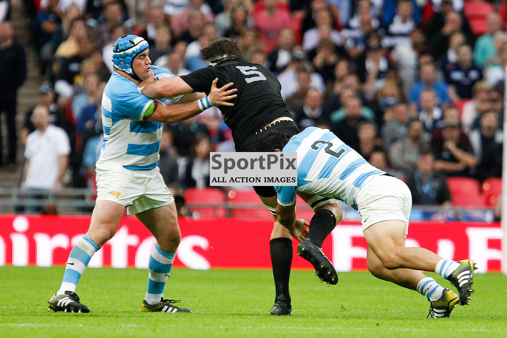 WEMBLEY, ENGLAND - SEPTEMBER 20:  Sam Whitelock of New Zealand tackled by Agustin Creevy (capt) of Argentina during the 2015 Rugby World Cup Pool C match between New Zealand and Argentina at Wembley Stadium on September 20, 2015 in London, England. (Credit: SAM TODD | SportPix.org.uk)