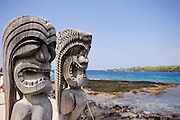 Wooden Tiki statues at the Place of Refuge on the Big Island of Hawaii.