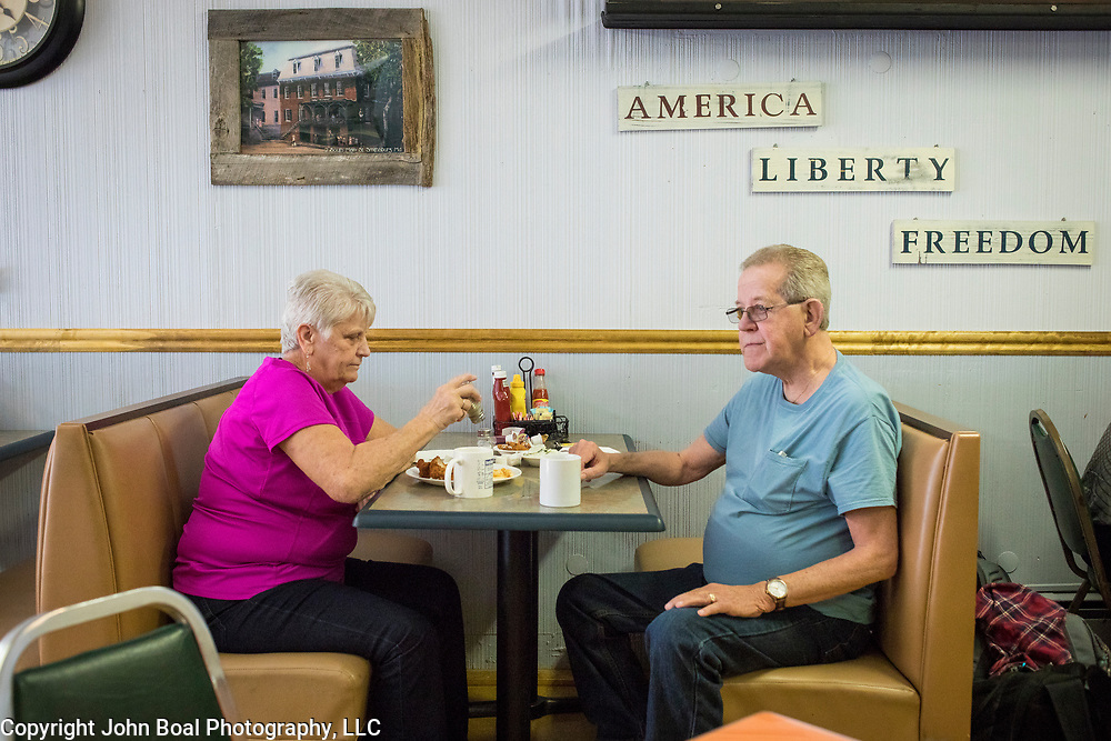 Jim and Nancy Nalley, of Hagerstown, eat lunch in the Dixie Diner, in downtown Smithsburg, Maryland, on Tuesday, September 26, 2017. The Nalleys have been coming to the diner for at least 10 years. Smithsburg is a very different town than the southern part of the district that includes Potomac and Germantown. Originally a District that was mostly rural, but included towns like Frederick and Hagerstown, Maryland's 6th District was redistricted in 2011, combining rural northern Maryland regions with more affluent communities like near Washington D.C. turning the district from Republican to Democrat. <br />  <br /> CREDIT: John Boal for The Wall Street Journal<br /> GERRYMANDER