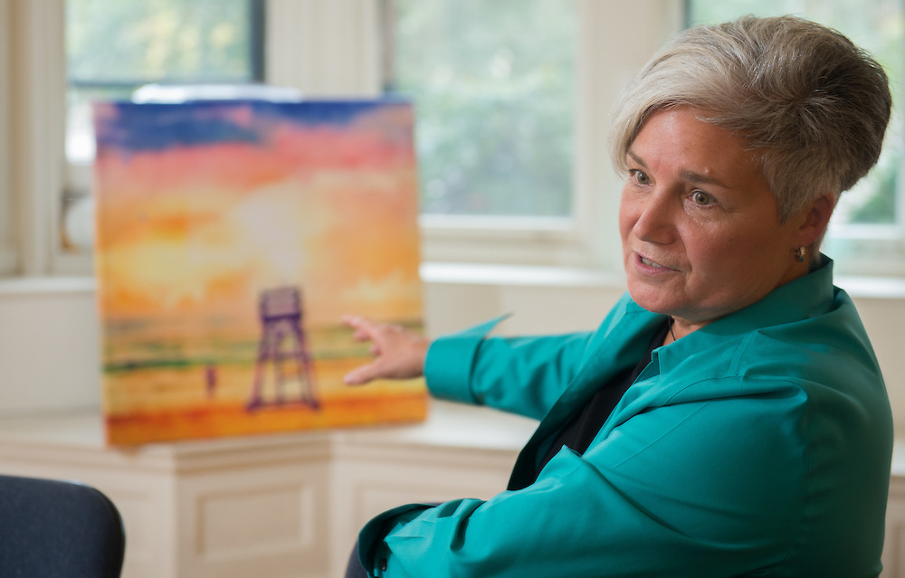 "Cindy Patrick, Moorestown-based artist, discusses the ""paintings"" she creates from her iPhone/iPad photos., Tuesday, October 14, 2014. (Photo: Bryan Woolston / @woolstonphoto)"