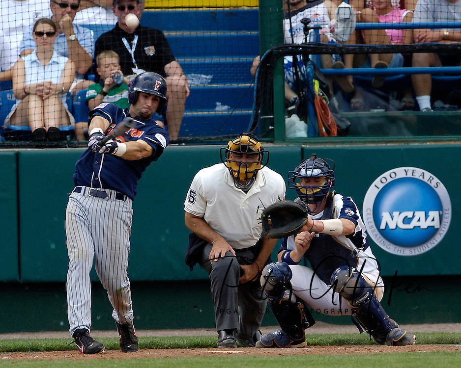 Cal State Fullerton's Brandon Tripp (L) drives a RBI triple off the center field wall against Georgia Tech.  Cal State Fullerton eliminated Georgia Tech with a 7-5 win at the College World Series at Rosenblatt Stadium in Omaha, Nebraska, June 18, 2006.