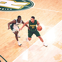 4th year guard, Myles Hamilton (11) of the Regina Cougars during the Men's Basketball Home Game on Sat Feb 02 at Centre for Kinesiology,Health and Sport. Credit: Arthur Ward/Arthur Images