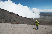 A hiker climbs up Cotopaxi volcano in Ecuador, one of the highest active volcanoes in the world.