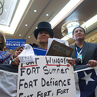 Nicole Walker from Churchrock stands in the front row at the Bernie Sanders town hall at Twin Arrows Casino in Flagstaff Thursday. Sanders is the first candidate in this election to visit the Navajo Nation.