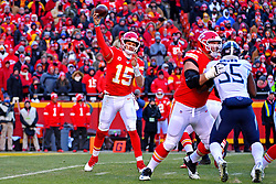 Jan 19, 2020; Kansas City, Missouri, USA; Kansas City Chiefs quarterback Patrick Mahomes (15) throws a pass against Tennessee Titans outside linebacker Kamalei Correa (44) during the first half in the AFC Championship Game at Arrowhead Stadium. Mandatory Credit: Denny Medley-USA TODAY Sports