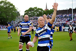 Peter Stringer of Bath Rugby waves to the crowd having just played his final home match for Bath Rugby - Photo mandatory by-line: Patrick Khachfe/JMP - Mobile: 07966 386802 23/05/2015 - SPORT - RUGBY UNION - Bath - The Recreation Ground - Bath Rugby v Leicester Tigers - Aviva Premiership Semi-Final