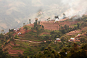 Terraced rice fields on a mountainside in Nepal. Rice is the main crop in Nepal, a country where 66% of the Nepali population work in agriculture and it provides approximately 33% of GDP. Nepal remains one of the poorest countries in Asia with a per capita GDP of $562.