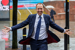 © Licensed to London News Pictures. 29/09/2019. Manchester, UK. Health Secretary Matt Hancock runs through the rain on first day of the Conservative Party Conference at Manchester Central in Manchester. Photo credit: Andrew McCaren/LNP