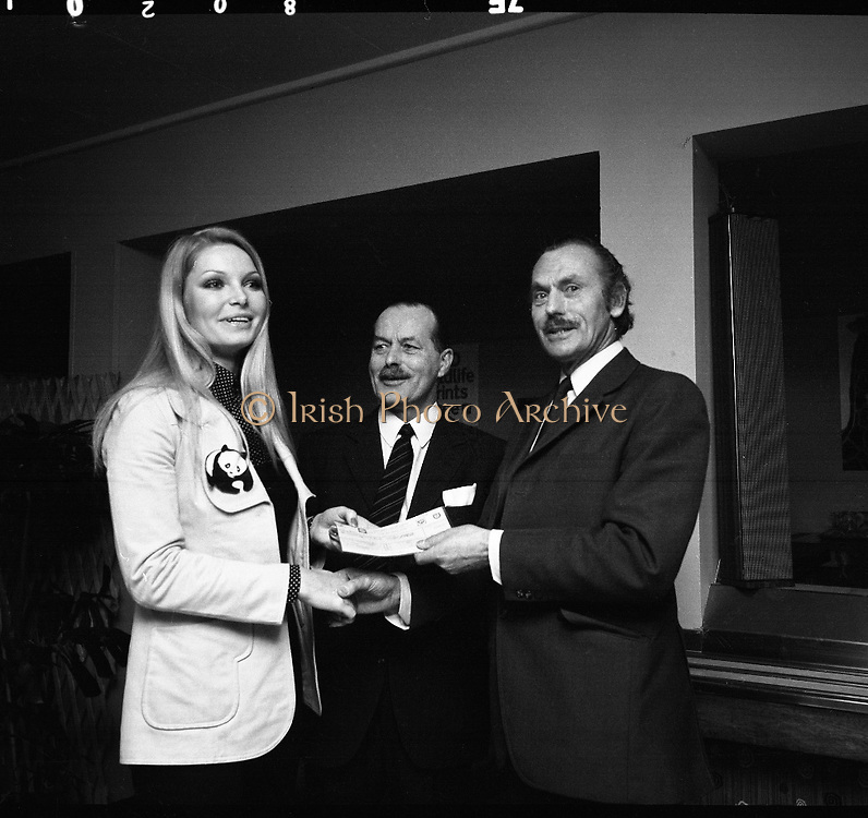 "Former Miss World Visits Dublin Zoo.<br /> 1973.<br /> 14.01.1973.<br /> 01.14.1973.<br /> 14th January 1973.<br /> Miss Eva Rueber-Staier, former Miss World from Austria and the ""World Wildlife Fund's Anniversary Girl"", paid her first visit to Ireland to open the Shell/BP Irish Wildlife Promotion. As part of the promotion Eva paid a visit to Dublin Zoo in the Phoenix Park, Dublin.<br /> <br /> Image shows Miss Rueber-Staier presenting a cheque of £1000 to Mr Terry Murphy, The Director, Dublin Zoo. Included in the picture is Mr Herbert James, Operations Manager, Shell/BP who donated the cheque as part of the wildlife promotion."