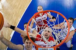 Erazem Lorbek (15) of Slovenia vs Marcin Gortat of Poland during the EuroBasket 2009 Group F match between Slovenia and Poland, on September 14, 2009 in Arena Lodz, Hala Sportowa, Lodz, Poland.  (Photo by Vid Ponikvar / Sportida)