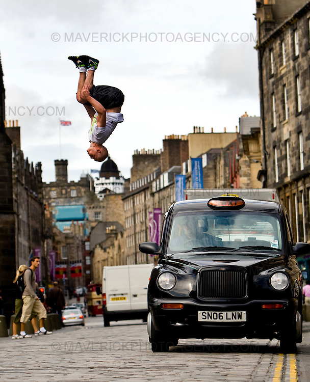 """.Stefan Brown leaps over a taxi on Edinburg's Royal Mile to launch the new """"Urbathon"""" event to be held in Scotlands capital...HUNDREDS of runners will have the chance to jump, climb and crawl their way through the capital in the first  10 kilometre race of its kind to take place in Scotland which involves obstacle course challenges. ..Picture Michael Hughes/Maverick."""