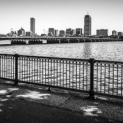 Boston skyline Harvard Bridge Back Bay black and white photo. Includes Charles River, John Hancock Tower, Prudential Tower and a railing along the Dr. Paul Dudley White Bike Path. Boston Massachusetts is a major city in the Eastern United States of America.