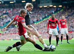 21.03.2010, Old Trafford, Manchester, ENG, PL, Manchester United vs Liverpool FC im Bild Liverpool's Fernando Torres once again eases past Manchester United's Nemanja Vidic., EXPA Pictures © 2010, PhotoCredit: EXPA/ Propaganda/ D. Rawcliffe / SPORTIDA PHOTO AGENCY