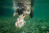 A young girl under the water at the popular Babinda Boulders.