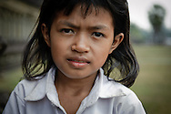 Cambodia, Siem Reap. Portrait of a young girl selling lotus in Angkor Wat.