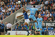 Chesterfield forward Chris O'Grady and Coventry City defender Jordan Willis challenge for the ball in the air during the EFL Sky Bet League 2 match between Chesterfield and Coventry City at the Proact stadium, Chesterfield, England on 2 September 2017. Photo by Aaron  Lupton.