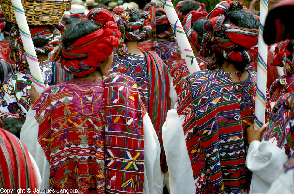 Ixil (Mayan) Indian women in ceremonial dress in a procession in Nebaj (Dept. El Quiche), Guatemala.