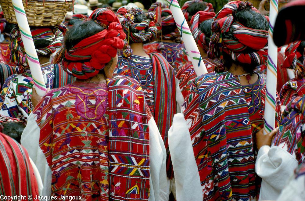 Ixil (Mayan) Indian women in ceremonial dress in a procession in Nebaj (Dept. El Quiche), Guatemala.