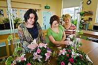 Students at Bishop Burton College, East Yorkshire. creating flower arrangements in the Floristry Studio, pictured LtoR students Kirstie Lythe, Janine Richardson and tutor Beverley Bradshaw.