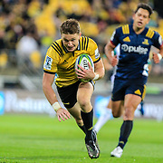 Beauden Barrett dives over to score during the super rugby union  game between Hurricanes  and Highlanders, played at Westpac Stadium, Wellington, New Zealand on 24 March 2018.  Hurricanes won 29-12.