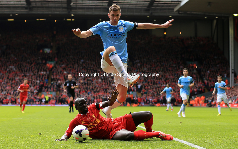 13th April 2014 - Barclays Premier League - Liverpool v Manchester City - Edin Dzeko of Man City skips over a challenge from Mamadou Sakho of Liverpool - Photo: Simon Stacpoole / Offside.