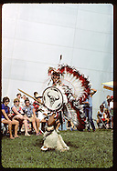 Indian dancer performs in front of St. Louis Arch during a folk festival on the park grounds. Missouri
