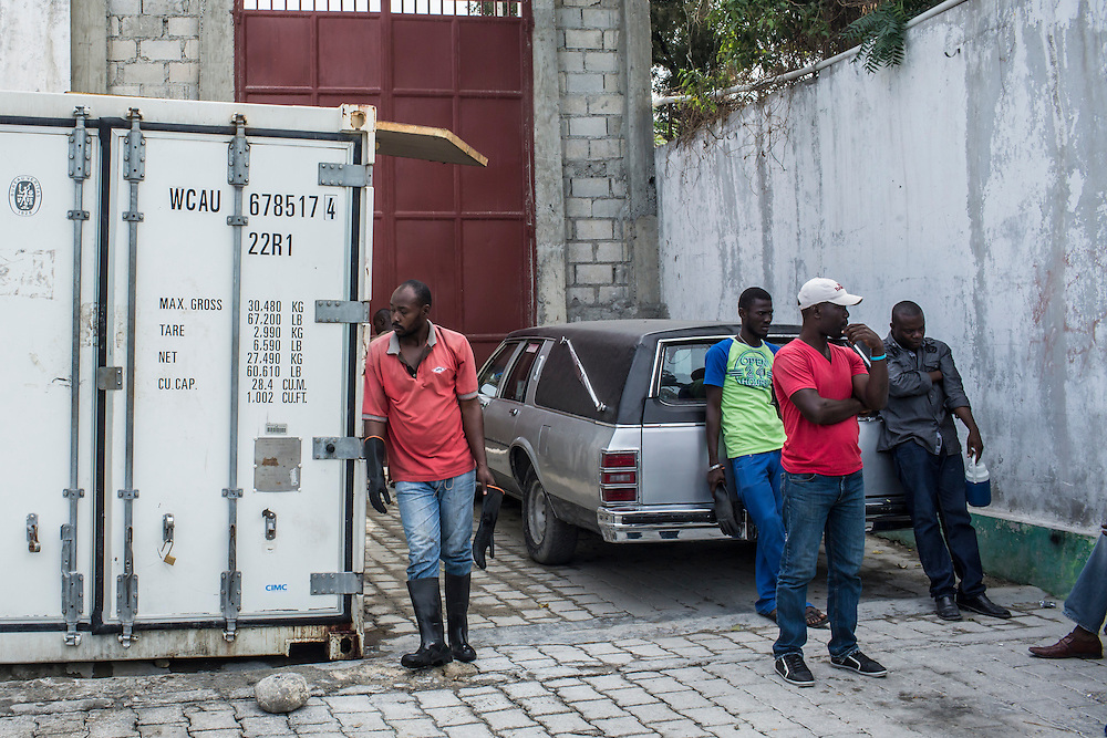 Workers at the morgue on Wednesday, December 17, 2014 in Port-au-Prince, Haiti.