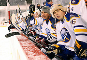 Andrew Peters, right, and Matthew Barnaby watch from the Sabres alumni bench during the Amerks vs. Sabres alumni game at Frontier Field in Rochester on Sunday, December 15, 2013.