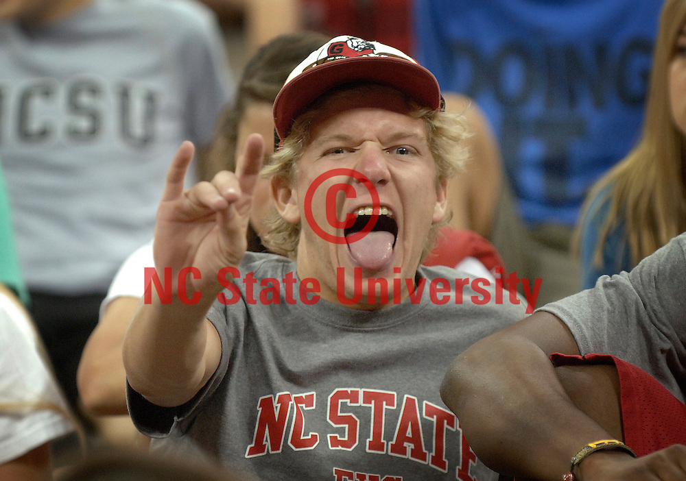 A student flashes his best wolfpack gesture.