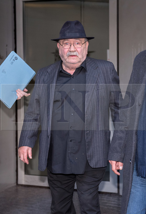 © Licensed to London News Pictures. 02/11/2018. Bristol, UK. SALVATORE LOPRESTI (in hat) leaves Bristol Crown Court on the first day of legal proceedings, charged with offences relating to modern slavery. Avon and Somerset Police have charged Salvatore 'Sam' Lopresti, 74, and Robert Lopresti, 45, with requiring a person to perform forced labour. Sam Lopresti was also charged with assault occasioning actual bodily harm.<br /> The family have run an ice cream business in the Bristol area for over 50 years. Photo credit: Simon Chapman/LNP