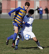 Lansing's Jason Yahn (15) moves the ball past Drew Phillips of Hoosick Falls during a Class C state semifinal boys' soccer game at Faller Field in Middletown on Saturday, Nov. 17, 2012.
