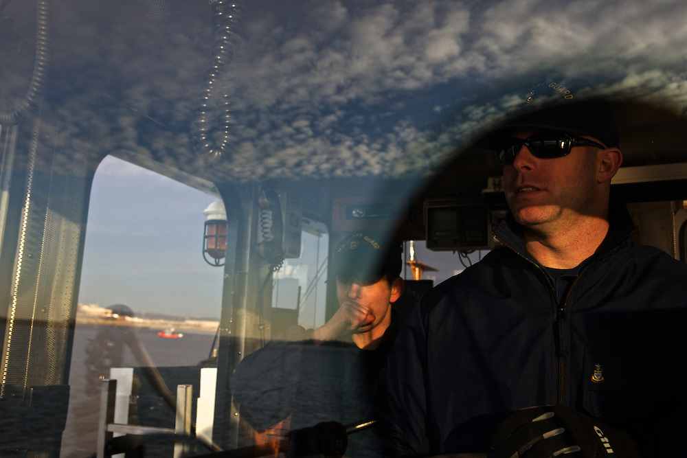 Senior Chief Brian Kuhar, right, and a crew with the U.S. Coast Guard patrols the Potomac River as a part of security measures taken for the Presidential Inauguration ceremonies in Washington, D.C., on January 21, 2013.