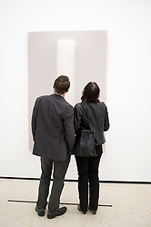 Visitors looking at painting Stylite II by Gotthard Graubner at Stadel museum in Frankfurt Germany