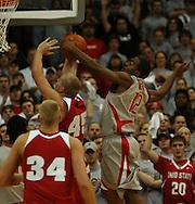 MORNING JOURNAL/DAVID RICHARD.Ron Lewis, right, of Ohio State blocks a shot attempt by Joe Krabbenhoft of Wisconsin Sunday, Feb. 25, 2007, in Columbus, Ohio. Ohio State beat Wisconsin 49-48.