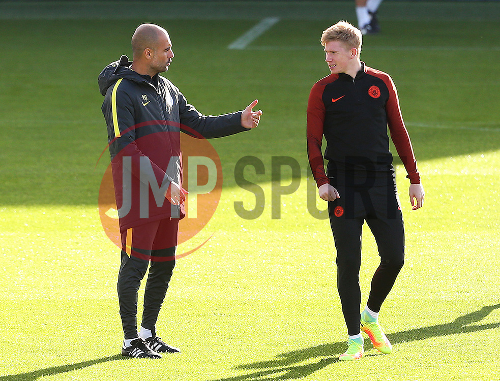 Manchester City manager Pep Guardiola talks with Kevin de Bruyne - Mandatory by-line: Matt McNulty/JMP - 18/10/2016 - FOOTBALL - Manchester City - Training session ahead of Champions League qualifier against FC Barcelona