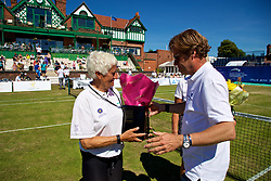 LIVERPOOL, ENGLAND - Sunday, June 24, 2018: Tournament director Anders Borg presents flowers to Liverpool Cricket Club volunteer Jean Arnold during day four of the Williams BMW Liverpool International Tennis Tournament 2018 at Aigburth Cricket Club. (Pic by Paul Greenwood/Propaganda)