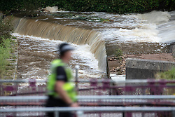 © Licensed to London News Pictures. 05/08/2019. Whaley Bridge, UK. Water is pumped out and down the secure side of the reservoir's slipway . The town of Whaley Bridge in Derbyshire remains evacuated after heavy rain caused damage to the Toddbrook Reservoir , threatening homes and businesses with flooding . Photo credit: Joel Goodman/LNP