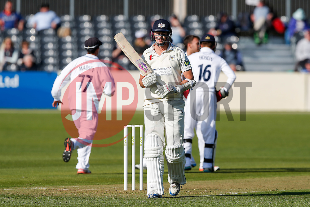 James Hughes of Gloucestershire walks after he is bowled L.B.W. for 6 by Alex Hughes of Derbyshire - Photo mandatory by-line: Rogan Thomson/JMP - 07966 386802 - 26/04/2015 - SPORT - CRICKET - Bristol, England - Bristol County Ground - Gloucestershire v Derbyshire — Day 1 - LV= County Championship Division Two.