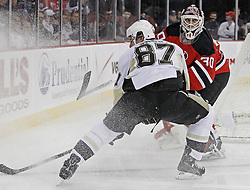 Dec 30, 2009; Newark, NJ, USA; New Jersey Devils goalie Martin Brodeur (30) plays the puck away from Pittsburgh Penguins center Sidney Crosby (87) during the first period at the Prudential Center.