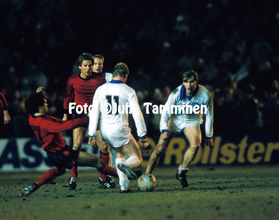 19.03.1986, Olympic Stadium, Helsinki, Finland..European Champions Cup, Quarter Final, 2nd leg match, FC Kuusysi v Steaua Bucuresti..Michael Carroll (11), Petri Tiainen & Seppo Nordman (Kuusysi) v Gavril Balint  & Ladislau Boloni (Steaua).©Juha Tamminen