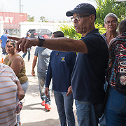 OCTOBER 20 - SANTA ISABEL, PUERTO RICO - <br /> Santa Isabel mayor Enrique Questell Alvarado, directs efforts to help residents pick up water and supplies in a  distribution center set up at the makeshift command center for the town. City hall sustained heavy damage and is unusable.<br /> (Photo by Angel Valentin/Freelance)