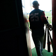 Clarinda A's second baseman Ryan Peterson leaves the team's locker room and heads for the field.  photo by David Peterson
