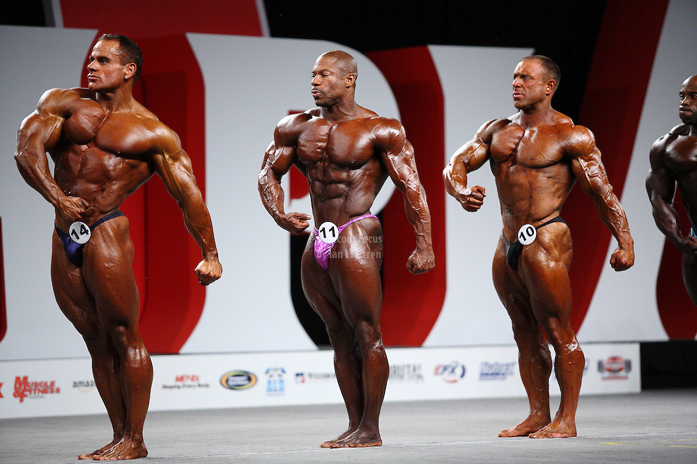 "On stage at the pre-judging for the 2009 Olympia 202 competition in Las Vegas..Lee Powell, Ricky ""Tricky"" Jackson, John Hodgson"