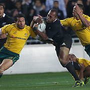 Sitiveni Sivivatu, New Zealand, is tackled by Digby Ioane, (left) Will Genia, (below) and Kurtley Beale, (right) during the New Zealand V Australia Tri-Nations, Bledisloe Cup match at Eden Park, Auckland. New Zealand. 6th August 2011. Photo Tim Clayton